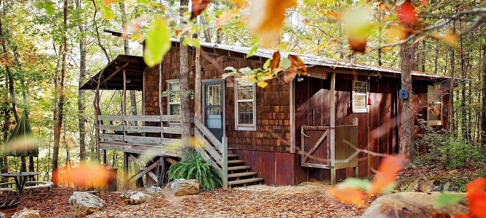 Beautiful exterior view of the cabin in the fall surrounded by colorful trees